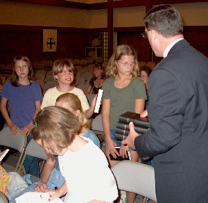 [Cliff Merrill gives Russian Bibles to Children from Chernobyl.]