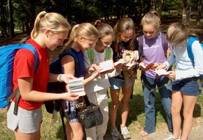 [Martin Middle School girls check out their new Testaments.]